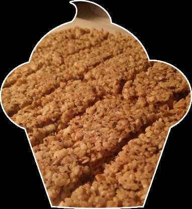 10 Après cuisson, laisser un peu refroidir (pas complètement) et découper avec un couteau les barres de céréales puis laisser refroidir.png